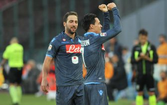 Napoli's forward Josè Maria Callejon (R) celebrates with his teammate Gonzalo Higuain (R) during the Italian Serie A soccer match between SSC Napoli and AS Roma at San Paolo Stadium in Naples, 1 November 2014. ANSA/ CESARE ABBATE