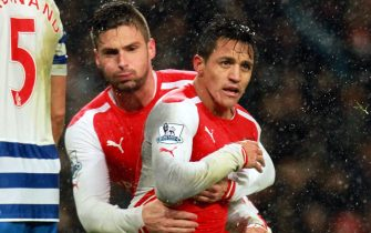 epa04540668 Arsenals Alexis Sanchez (17) celebrates his goal with Olivier Giroud during the English Premier League match between Arsenal v Queens park Rangers at the Emirates in London, Britain, 26 December 2014.  EPA/SEAN DEMPSEY