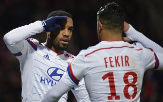 Lyon's French forward Alexandre Lacazette (L) celebrates with forward Nabil Fekir after scoring a penalty during the French L1 football match Olympique Lyonnais (OL) vs Caen (SMC) on December 12, 2014, at the Gerland Stadium in Lyon, central-eastern France. AFP PHOTO / JEFF PACHOUD        (Photo credit should read JEFF PACHOUD/AFP via Getty Images)