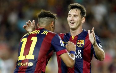 FC Barcelona Neymar Jr. (L) celebrates his goal with Lionel Messi (R) during the match against Leon of Mexico for the Joan Gamper trophy at Camp Nou stadium in Barcelona, Spain, 18 August 2014. EFE/Toni Albir