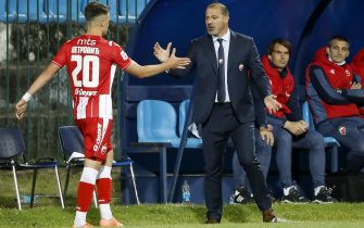 BELGRADE, SERBIA - MAY 29: Head coach Dejan Stankovic (R) of Crvena Zvezda shake hands with Njegos Petrovic (L) during the LingLong Super League match between FC Rad and FK Crvena Zvezda on May 29, 2020 in Belgrade, Serbia. (Photo by Srdjan Stevanovic/Getty Images)