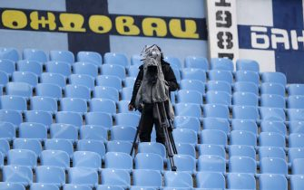 epa08453146 A TV camera in the empty stands during the Serbian SuperLiga soccer match between Rad and Red Star in Belgrade, Serbia, 29 May 2020. The Serbian SuperLiga resumes without spectators after a suspension because of the coronavirus pandemic.  EPA/ANDREJ CUKIC