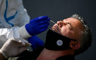 A Kosovar football referee gets tested for COVID-19 at the Fadil Vokrri Stadium in Pristina on May 30, 2020. - Since March 14, all sporting events have been postponed in Kosovo, due to the risk of the Coronavirus pandemic. (Photo by Armend NIMANI / AFP) (Photo by ARMEND NIMANI/AFP via Getty Images)