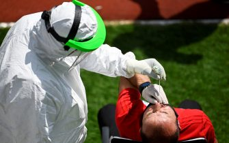 TOPSHOT - A Kosovar football referee gets tested for COVID-19 at the Fadil Vokrri Stadium in Pristina on May 30, 2020. - Since March 14, all sporting events have been postponed in Kosovo, due to the risk of the Coronavirus pandemic. (Photo by Armend NIMANI / AFP) (Photo by ARMEND NIMANI/AFP via Getty Images)