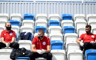 Kosovar football referees wait to get tested for COVID-19 at the Fadil Vokrri Stadium in Pristina on May 30, 2020. - Since March 14, all sporting events have been postponed in Kosovo, due to the risk of the Coronavirus pandemic. (Photo by Armend NIMANI / AFP) (Photo by ARMEND NIMANI/AFP via Getty Images)