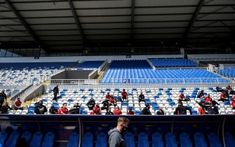Kosovar football referees sit and wait to get tested for COVID-19 at the Fadil Vokrri Stadium in Pristina on May 30, 2020. - Since March 14, all sporting events have been postponed in Kosovo, due to the risk of the Coronavirus pandemic. (Photo by Armend NIMANI / AFP) (Photo by ARMEND NIMANI/AFP via Getty Images)