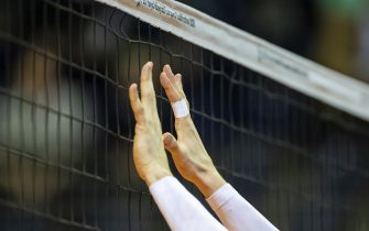 Serbia's Serbia's  middle blocker Srecko Lisinac holds his hands towards the net during the pool B Men's CEV Tokyo Volleyball European Qualification 2020 match at the Max Schmeling Halle in Berlin on January 06, 2020. (Photo by Odd ANDERSEN / AFP) (Photo by ODD ANDERSEN/AFP via Getty Images)