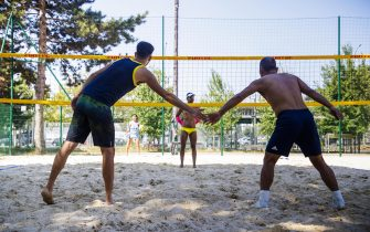 epa06928629 Athletes in action during the Beach Volley competition of the 10th Gay Games in Paris, France, 05 August 2018. The Gay Games, a mix of sports and festives events, are the worldâs largest rally for the rights of gays and lesbians and are held every four years since 1982.  EPA/CHRISTOPHE PETIT TESSON
