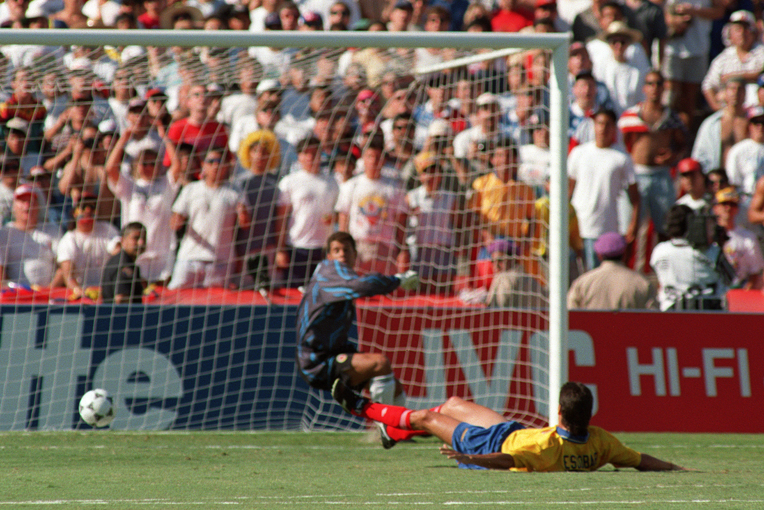 Colombian defender Andres Escobar lies on the ground after scoring an own goal past goalkeeper Oscar Cordoba while trying to stop a shot from US forward John Harkes during the World Cup first round soccer match between the United States and Colombia 22 June 1994 in Los Angeles. The United States beat Colombia 2-1. AFP PHOTO/ROMEO GACAD (Photo by Romeo GACAD / AFP) (Photo by ROMEO GACAD/AFP via Getty Images)