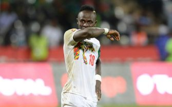 epa05758067 Sadio Mane of Senegal reacts in disappointment for missing a penalty, during the Quarter Final match between Senegal and Cameroon in Franceville, Gabon, 28 January 2017.  EPA/SYDNEY MAHLANGU