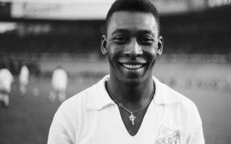 """Brazilian striker Pelé, wearing his Santos jersey, smiles before playing a friendly soccer match with his club against the French club of """"Racing"""", on June 13, 1961 in Colombes, in the suburbs of Paris.  Pelé score one goal as Santos won 5-4. Widely considered to be the greatest player in soccer history, Pelé scored 1282 goals in his career and won three World Cup titles with Brazil (1958 in Sweden, 1962 in Chile, 1970 in Mexico). / AFP PHOTO / -        (Photo credit should read -/AFP via Getty Images)"""