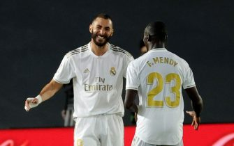 epa08494900 Real Madrid's striker Karim Benzema (L) celebrates with Ferland Mendy (R) after scoring the third goal, during the Spanish LaLiga soccer match between Real Madrid and Valencia at Alfredo Di Stefano Stadium in Madrid, Spain, 18 June 2020.  EPA/JUANJO MARTIN