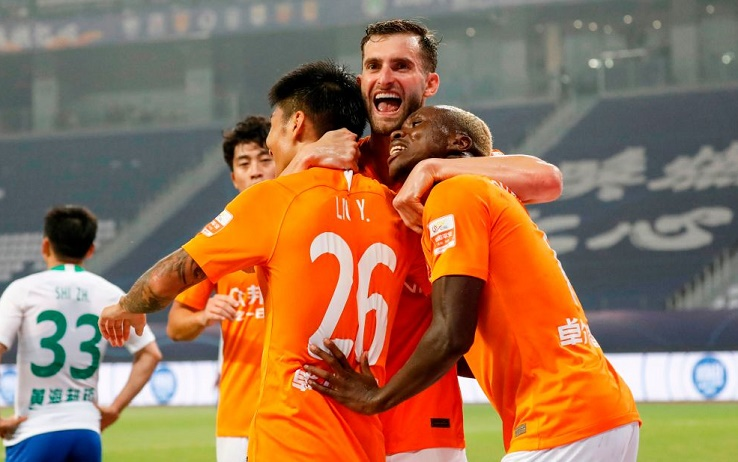 Players of Wuhan Zall celebrate after scored during their Chinese Super League (CSL) football match with Qingdao Huanghai in Suzhou in China's eastern Jiangsu province on July 25, 2020. - Wuhan Zall players were given a guard of honour and medical staff from the city were applauded as Chinese football made an emotional return on July 25 following a long delay because of coronavirus. (Photo by STR / AFP) / China OUT (Photo by STR/AFP via Getty Images)
