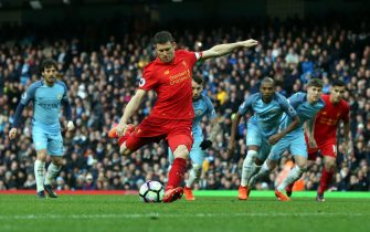 epa05858482 Liverpool's James Milner (C) shoots to score a penalty during the English Premier League soccer match between Manchester City and Liverpooll at the Etihad Stadium, Manchester, Britain, 19 March 2017.  EPA/Nigel Roddis EDITORIAL USE ONLY. No use with unauthorized audio, video, data, fixture lists, club/league logos or 'live' services. Online in-match use limited to 75 images, no video emulation. No use in betting, games or single club/league/player publications