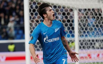 epa07386123 Zenit's player Sardar Azmoun celebrates after scoring a goal against Fenerbahce during the UEFA Europa League round of 32 second leg soccer match between Zenit and Fenerbahce in St. Petersburg, Russia, 21 February 2019.  EPA/ANATOLY MALTSEV