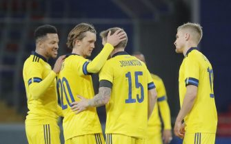 epa08730095 Kristoffer Olsson (2L) and Mattias Johansson (3L) of Sweden celebrate winning the international friendly soccer match between Russia and Sweden at VTB Arena in Moscow, Russia, 08 October 2020.  EPA/MAXIM SHIPENKOV