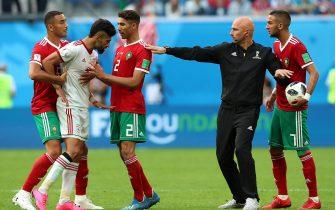 epa06810931 Ramin Rezaeian (2-L) of Iran scuffles with Achraf Hakimi (3-L) of Morocco during the FIFA World Cup 2018 group B preliminary round soccer match between Morocco and Iran in St.Petersburg, Russia, 15 June 2018.(RESTRICTIONS APPLY: Editorial Use Only, not used in association with any commercial entity - Images must not be used in any form of alert service or push service of any kind including via mobile alert services, downloads to mobile devices or MMS messaging - Images must appear as still images and must not emulate match action video footage - No alteration is made to, and no text or image is superimposed over, any published image which: (a) intentionally obscures or removes a sponsor identification image; or (b) adds or overlays the commercial identification of any third party which is not officially associated with the FIFA World Cup)  EPA/TOLGA BOZOGLU   EDITORIAL USE ONLY  EPA-EFE/TOLGA BOZOGLU   EDITORIAL USE ONLY  EDITORIAL USE ONLY  EPA-EFE/TOLGA BOZOGLU   EDITORIAL USE ONLY  EDITORIAL USE ONLY  EDITORIAL USE ONLY  EPA-EFE/TOLGA BOZOGLU   EDITORIAL USE ONLY  EDITORIAL USE ONLY  EDITORIAL USE ONLY  EDITORIAL USE ONLY