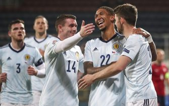 epa08653162 Ryan Christie (R) of Scotland celebrates with his team mate Liam Palmer (2-R) after scoring from penalty during the UEFA Nations League group stage soccer match between Czech Republic and Scotland in Olomouc, Czech Republic, 07 September 2020.  EPA/MARTIN DIVISEK