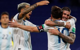 epa08730787 Lionel Messi (C) of Argentina celebrates after scoring during the South American qualifiers for the Qatar 2022 World Cup between the national soccer teams of Argentina and Ecuador, at La Bombonera stadium in Buenos Aires, Argentina, 08 October 2020.  EPA/AGUSTIN MARCARIAN POOL