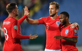 epa07921174 Raheem Sterling (R) of England celebrates after scoring with his teammates Harry Kane (C) and Jordan Henderson (L) during the UEFA EURO 2020 qualifying group A soccer match between Bulgaria and England at Vassil Levski stadium in Sofia, Bulgaria, 14 October 2019.  EPA/GEORGI LICOVSKI