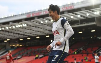 epa08720561 Tottenham's Son Heung-Min celebrates after scoring the 1-4 goal during the English Premier League match between Manchester United and Tottenham Hotspur in Manchester, Britain, 04 October 2020.  EPA/Oli Scarff / POOL EDITORIAL USE ONLY. No use with unauthorized audio, video, data, fixture lists, club/league logos or 'live' services. Online in-match use limited to 120 images, no video emulation. No use in betting, games or single club/league/player publications.