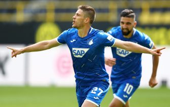 epa08512247 Andrej Kramaric of TSG 1899 Hoffenheim celebrates after scoring his team's third goal  during the Bundesliga match between Borussia Dortmund and TSG 1899 Hoffenheim at Signal Iduna Park on June 27, 2020 in Dortmund, Germany.  EPA/Martin Rose / POOL DFL regulations prohibit any use of photographs as image sequences and/or quasi-video.