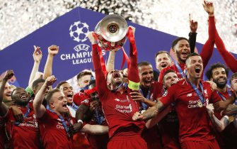 epa08301684 (FILE) - Liverpool FC captain Jordan Henderson lifts the trophy after the UEFA Champions League final between Tottenham Hotspur and Liverpool FC at the Wanda Metropolitano stadium in Madrid, Spain, 01 June 2019 (re-issued 17 March 2020). Amid the COVID-19 Cronavirus pandemic UEFA, on 17 March 2020, announced the 'commitment to complete all domestic and European club competitions by the end of the current sporting season, i.e. 30 June 2020 at the latest, should the situation improve' and 'possible adaptations of the 2020/21 UEFA Champions League and UEFA Europa League qualifying rounds in case of late completion of the 2019/20 sporting season, i.e. after 30 June 2020'.  EPA/Emilio Naranjo *** Local Caption *** 55242276