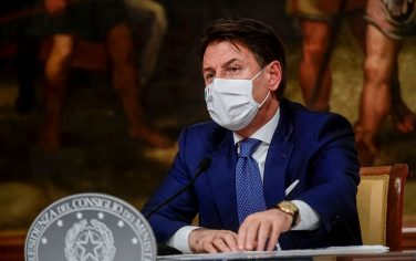 ROME, ITALY - DECEMBER 03: Italian Prime Minister Giuseppe Conte holds a press conference to announce a new emergency decree on Coronavirus restrictions, at Palazzo Chigi, on December 3, 2020 in Rome, Italy. Today Italian Prime Minister Giuseppe Conte signed a new decree (DPCM) to contain the spread of COVID-19 pandemic. Under the new decree, which is set to come into force from December 4 until January 6, people will only be allowed to be out of the home from 22:00 to 05:00 for work or health reasons. The movement between regions will be banned from December 21 until January 6 and it will not be possible to move outside one's town or city of residence on Christmas Day, St Stephen's Day and New Year's Day. Italy registered 23225 new infections and 993 deaths from Covid-19 in the last 24 hours. (Photo by AM POOL/Augusto Casasoli / AM POOL via Getty Images)