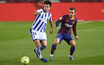Antoine Griezmann of FC Barcelona and Martin Zubimendi of Real Sociedad during the La Liga match between FC Barcelona and Real Sociedad played at Camp Nou Stadium on December 19, 2020 in Barcelona, Spain. (Photo by PRESSINPHOTO)