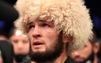 ABU DHABI, UNITED ARAB EMIRATES - OCTOBER 25:  Khabib Nurmagomedov of Russia announces his retirement in the Octagon after his victory over Justin Gaethje in their lightweight title bout during the UFC 254 event on October 25, 2020 on UFC Fight Island, Abu Dhabi, United Arab Emirates. (Photo by Josh Hedges/Zuffa LLC via Getty Images)