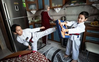 ISTANBUL, TURKAY - MAY 18: 15-year-old Turkish national taekwondo practitioner Sude Yaren Uzuncavdar' s brothers do taekwondo at home in Istanbul, Turkey on May 18, 2020. Sude maintains her training at home due to coronavirus (Covid-19) pandemic measures with her father, grandmother and aunt who are national taekwondo practitioners. (Photo by Sebnem Coskun/Anadolu Agency via Getty Images)