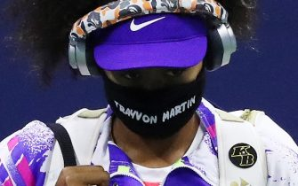 NEW YORK, NEW YORK - SEPTEMBER 06: Naomi Osaka of Japan walks out wearing a mask with the name of Trayvon Martin printed on it before her Womenâ  s Singles fourth round match against Anett Kontaveit of Estonia on Day Seven of the 2020 US Open at the USTA Billie Jean King National Tennis Center on September 6, 2020 in the Queens borough of New York City. (Photo by Matthew Stockman/Getty Images)