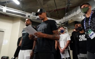 ORLANDO, FL - AUGUST 26: George Hill of the Milwaukee Bucks reads a statement to the media on August 26, 2020 at AdventHealth Arena at ESPN Wide World of Sports Complex in Orlando, Florida. NOTE TO USER: User expressly acknowledges and agrees that, by downloading and/or using this photograph, user is consenting to the terms and conditions of the Getty Images License Agreement.  Mandatory Copyright Notice: Copyright 2020 NBAE (Photo by Jesse D. Garrabrant/NBAE via Getty Images)