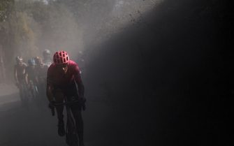 TOPSHOT - Team EF Pro Cycling Italian rider Alberto Bettiol pedal during a break away through a dusty gravel road in the one-day classic cycling race Strade Bianche (White Roads) on August 1, 2020 around Siena, Tuscany. (Photo by Marco Bertorello / AFP) (Photo by MARCO BERTORELLO/AFP via Getty Images)