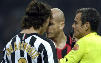 29 October 2005. Ibrahimovic of Juventus and Jaap Stam of Milan compete for the ball during the 10th Serie A round league match played between Milan and Juventus at -Giuseppe Meazza- stadium in Milan.