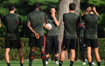 AC Milan's Swedish forward Zlatan Ibrahimovic gestures on September 27, 2011 during a training session at Mlanello in Carnago on the eve of their Champions League matchday 2, Group D against Viktoria Plzen. AFP PHOTO / OLIVIER MORIN (Photo credit should read OLIVIER MORIN/AFP/Getty Images)