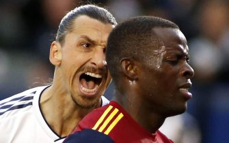 CARSON, CALIFORNIA - APRIL 28:   Zlatan Ibrahimovic #9 of Los Angeles Galaxy yells at Nedum Onuoha #14 of Real Salt Lake after scoring a goal during the second half of a game at Dignity Health Sports Park on April 28, 2019 in Carson, California. (Photo by Katharine Lotze/Getty Images)