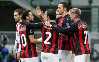 AC Milan's Zlatan Ibrahimovic jubilates with his teammates after scoring the goal of 2 to 0 during the Italian serie A soccer match between AC Milan and Fc Crotone at Giuseppe Meazza stadium in Milan, 7 February  2021.ANSA / MATTEO BAZZI