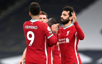 Liverpool's Roberto Firmino (left) celebrates scoring their side's first goal of the game with team-mate Mohamed Salah during the Premier League match at the Tottenham Hotspur Stadium, London. Picture date: Thursday January 28, 2021.