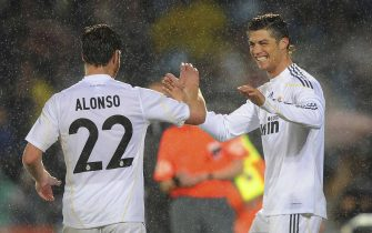 GETAFE, SPAIN - MARCH 25:  Cristiano Ronaldo of Real Madrid celebrates with Xabi Alonso after scoring Real's first goal during La Liga match between Getafe and Real Madrid at the Coliseum Alfonso Perez stadium on March 25, 2010 in Getafe, Spain.  (Photo by Denis Doyle/Getty Images)