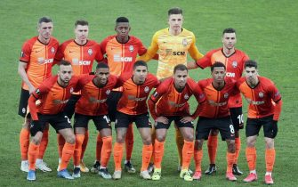 KYIV, UKRAINE - MARCH 18, 2021 - Players of FC Shakhtar Donetsk line up before the UEFA Europa League Round of 16 2nd leg game against A.S. Roma at the NSC Olimpiyskiy, Kyiv, capital of Ukraine.