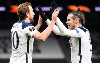 epa09068796 Tottenham's Harry Kane (L) celebrates with Gareth Bale (R) after scoring the 2-0 during the UEFA Europa League round of 16, first leg soccer match between Tottenham Hotspur and Dinamo Zagreb in London, Britain, 11 March 2021.  EPA/Neil Hall / POOL