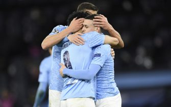 epa09119465 Phil Foden (R) of Manchester City celebrates with teammate Ilkay Gundogan (L) after scoring the 2-1 lead during the UEFA Champions League quarterfinal, 1st leg soccer match between Manchester City and Borussia Dortmund in Manchester, Britain, 06 April 2021.  EPA/PETER POWELL