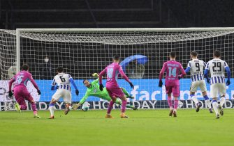 epa08949903 Goalkeeper Oliver Baumann of TSG Hoffenheim (CL) saves the penalty of Krzysztof Piatek of Hertha Berlin  during the Bundesliga match between Hertha BSC and TSG Hoffenheim at Olympiastadion in Berlin, Germany, 19 January 2021.  EPA/BORIS STREUBEL / POOL DFL regulations prohibit any use of photographs as image sequences and/or quasi-video.