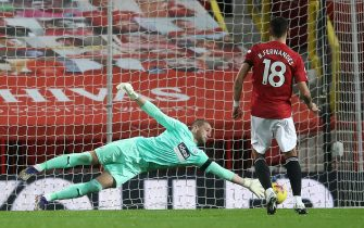 West Bromwich Albion goalkeeper Sam Johnstone saves the first penalty attempt from Manchester United's Bruno Fernandes during the Premier League match at Old Trafford, Manchester.