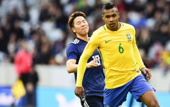 epa06320389 Alex Sandro (R) of Brazil in action against Takuma Asano (L) of Japan during the International Friendly soccer match between Japan and Brazil in Lille, France, 10 November 2017. Brazil won 3-1.  EPA/JEAN-BAPTISTE AUTISSIER FRANCE OUT / BELGIUM OUT