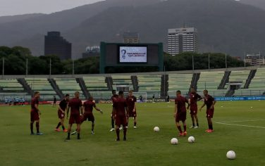 Venezuelan players warm up before the South American qualification football match for the FIFA World Cup Qatar 2022 against Uruguay at the UCV Olympic Stadium in Caracas on June 8, 2021. (Photo by MANAURE QUINTERO / POOL / AFP) (Photo by MANAURE QUINTERO/POOL/AFP via Getty Images)