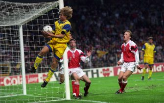 Parma's Tomas Brolin catches the ball as it goes out of play, watched by Arsenal's Nigel Winterburn (c) and Lee Dixon (r)   (Photo by Neal Simpson - PA Images via Getty Images)