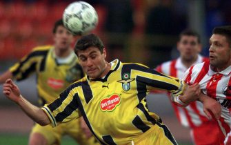 MOS01D:SPORT-SOCCER:MOSCOW,8APR99 - Alexei Arifullin (R) of Lokomotiv Moscow holds Christian Vieri of S.S. Lazio of Rome during their Cup Winners' cup first leg semi-final April 8.           cvi/Photo by Grigory Dukor           REUTERS