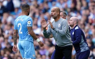 Manchester City manager Pep Guardiola with Kyle Walker during the Premier League match at The Etihad Stadium, Manchester. Picture date: Saturday September 18, 2021.